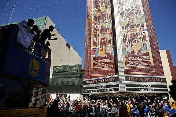 Stephen Curry applauds the crowd during Golden State Warriors' victory parade down Broadway in Oakland, Calif., on Friday, June 19, 2015.