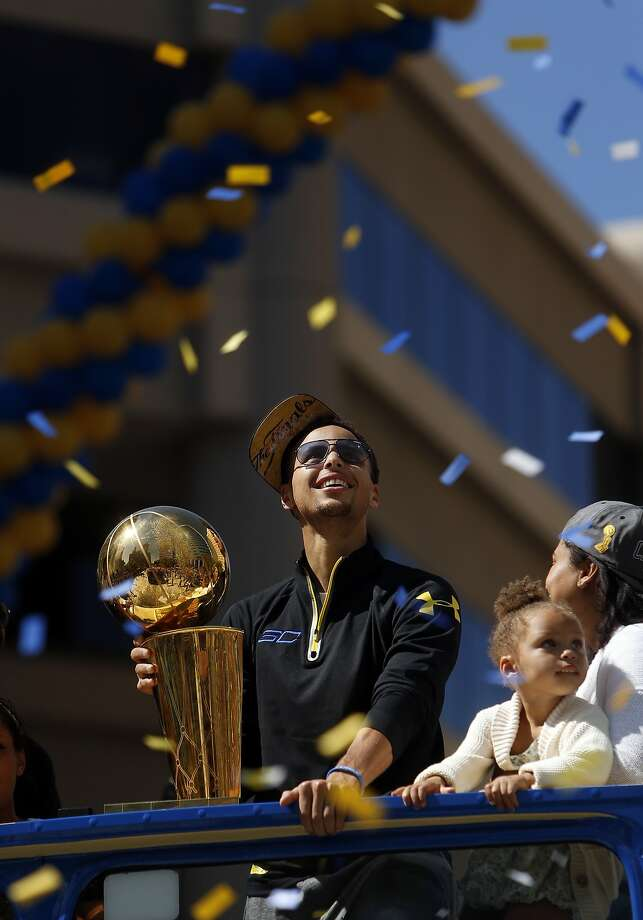 Stephen Curry and his daughter Riley soak in the atmosphere during Golden State Warriors' victory parade down Broadway in Oakland, Calif., on Friday, June 19, 2015. Photo: Scott Strazzante, The Chronicle