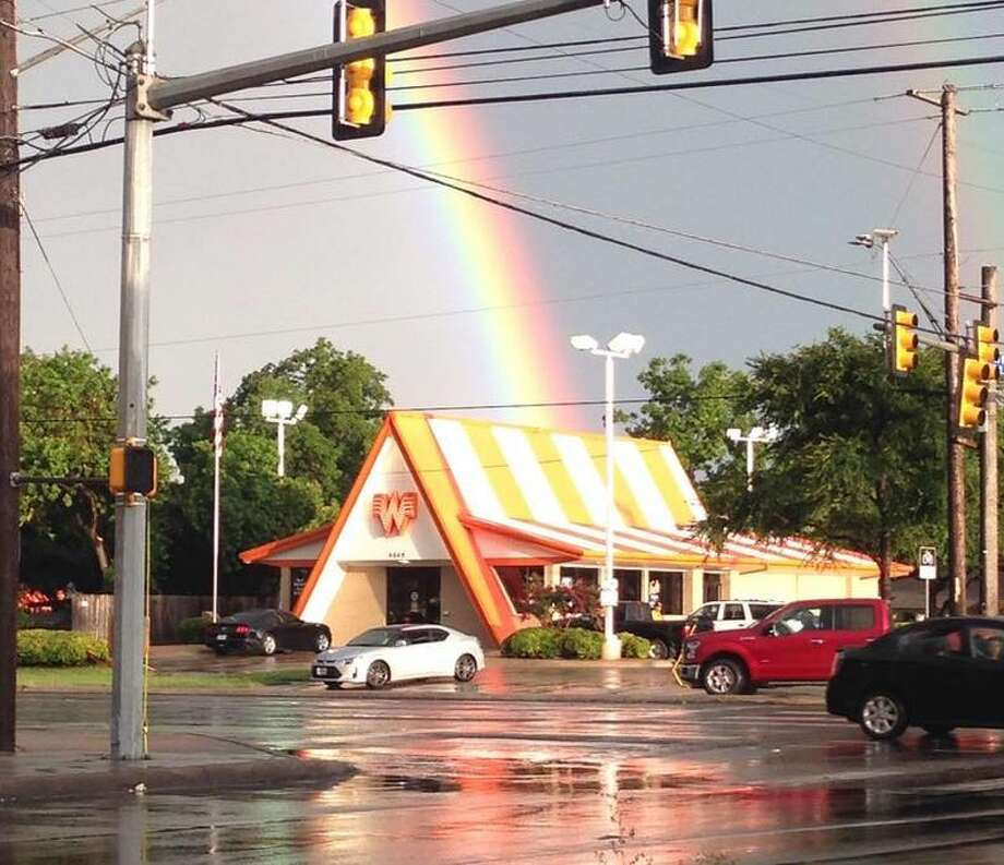 Texans know Whataburger is golden and Mother Nature agreed Wednesday afternoon when the storm quieted and a double rainbow arched over the city with a location of the mouth-watering chain at the end of it. Photo: Mendoza, Madalyn S, Provided By Sarah LLoyd