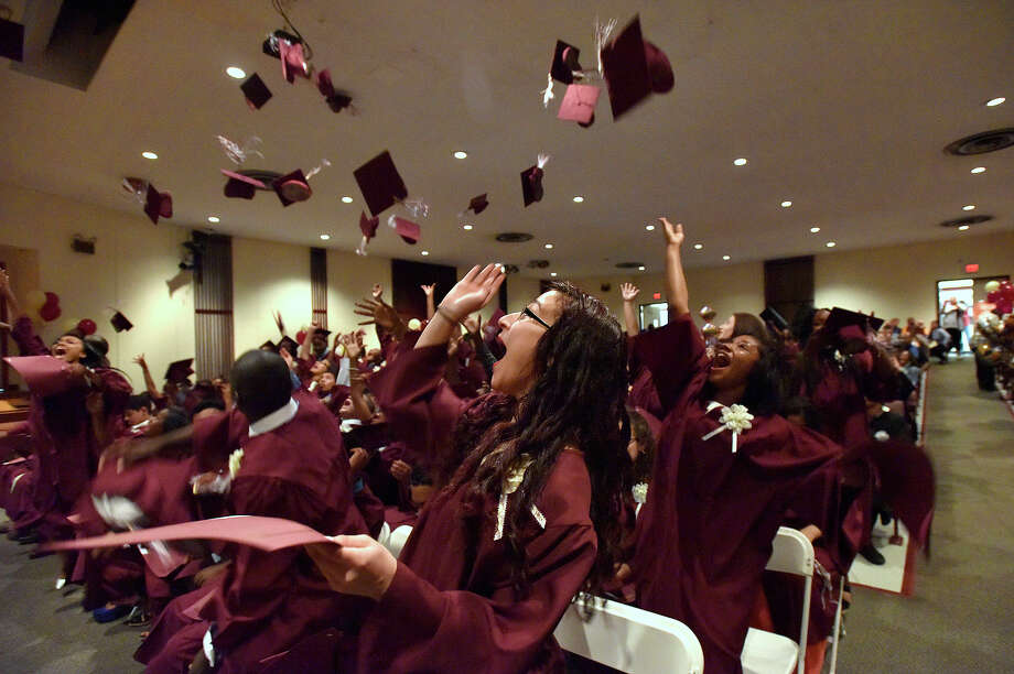 Savannah Adam, center, and other graduates toss their moartarboards into the air during the graduation ceremony for Trailblazers Academy in Stamford, Conn., on Friday, June 19, 2015. Photo: Jason Rearick / Hearst Connecticut Media / Stamford Advocate