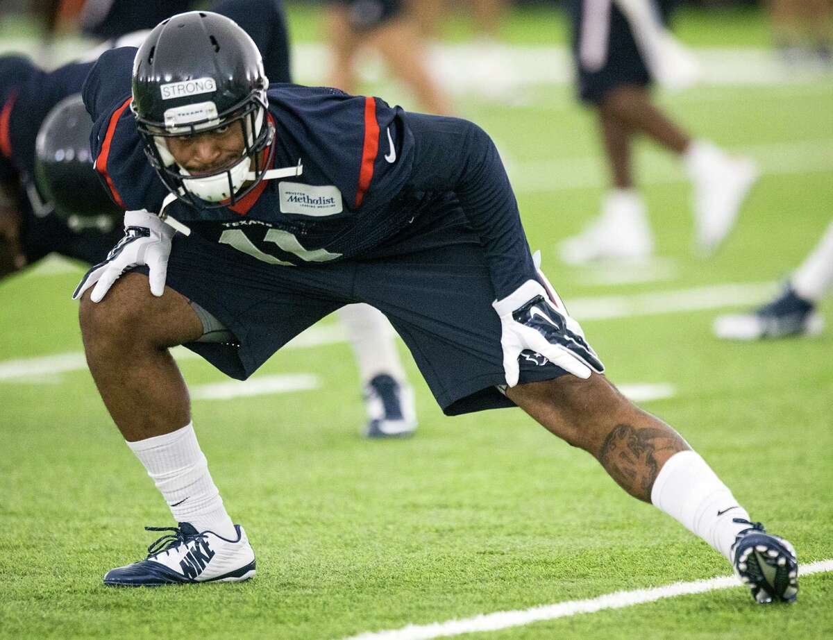 Jaelen Strong stretches during minicamp.
