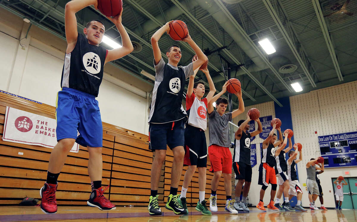 Basketball players run drills during The Basketball Embassy's inaugural Assembly 2015 camp Thursday June 18, 2015 at Our Lady of the Lake University's Mabee Gym.