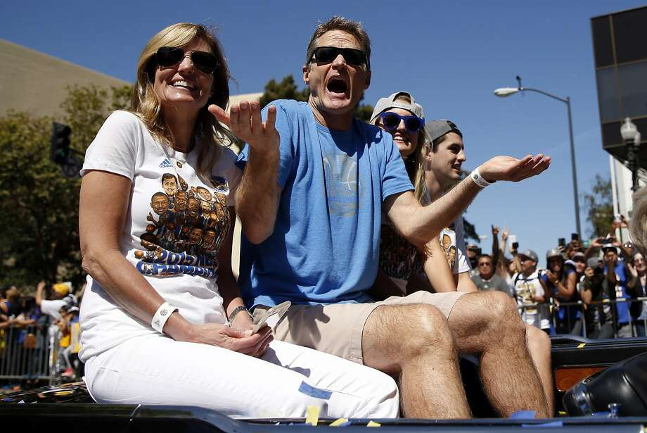 Steve Kerr and his wife Margot enjoy the Golden State Warriors' victory parade down Broadway in Oakland, Calif., on Friday, June 19, 2015. Photo: Scott Strazzante, The Chronicle