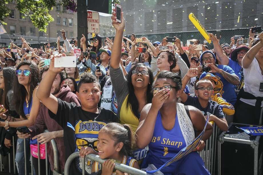 Parade attendees during the Golden State Warriors victory parade in Oakland on June 19th 2015. Photo: Sam Wolson, Special To The Chronicle