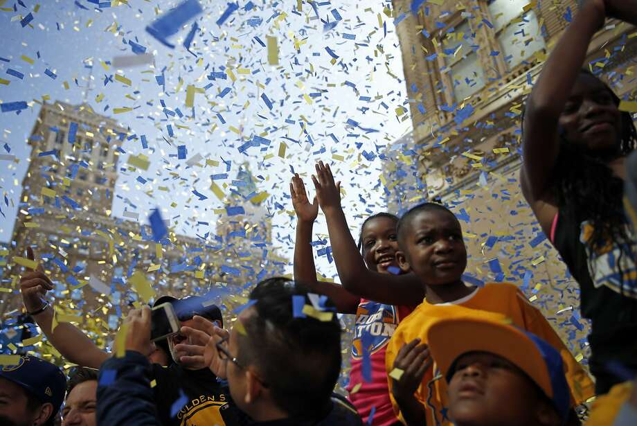 Fans enjoy the Golden State Warriors' victory parade down Broadway in Oakland, Calif., on Friday, June 19, 2015. Photo: Scott Strazzante, The Chronicle