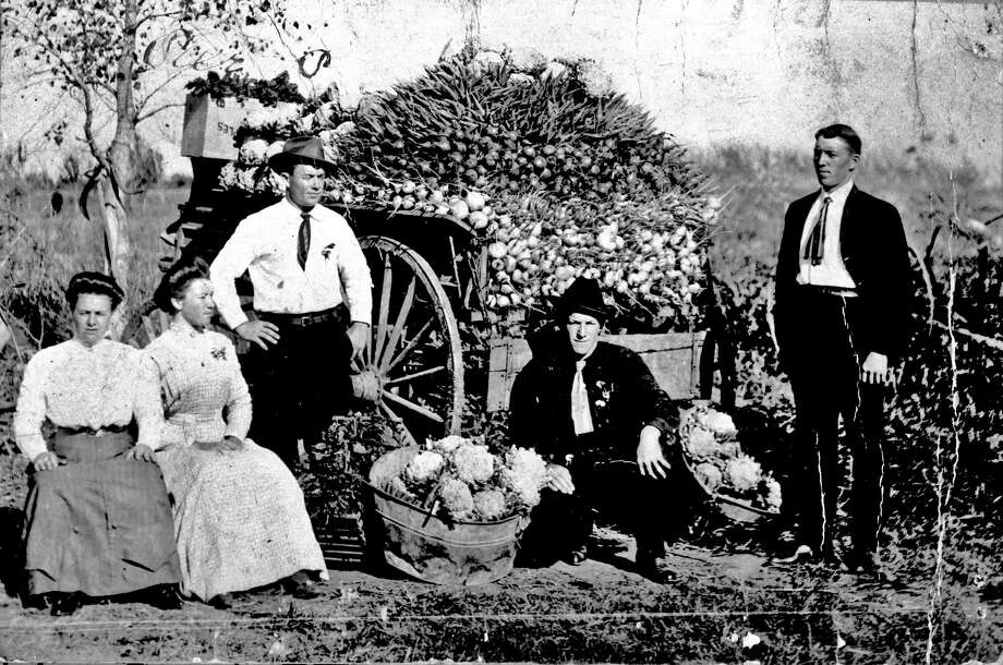 Marie Persyn (wife of Arthur), Hortense Persyn, Pete Persyn, Arthur Persyn, and Gus Persyn pose in 1911 beside a vegetable cart on a farm near San Antonio. Vegetables included cauliflower, beets and turnips that the family regularly sold at Haymarket Plaza in San Antonio. Photo: Courtesy UTSA Special Collections / UTSA Special Collections