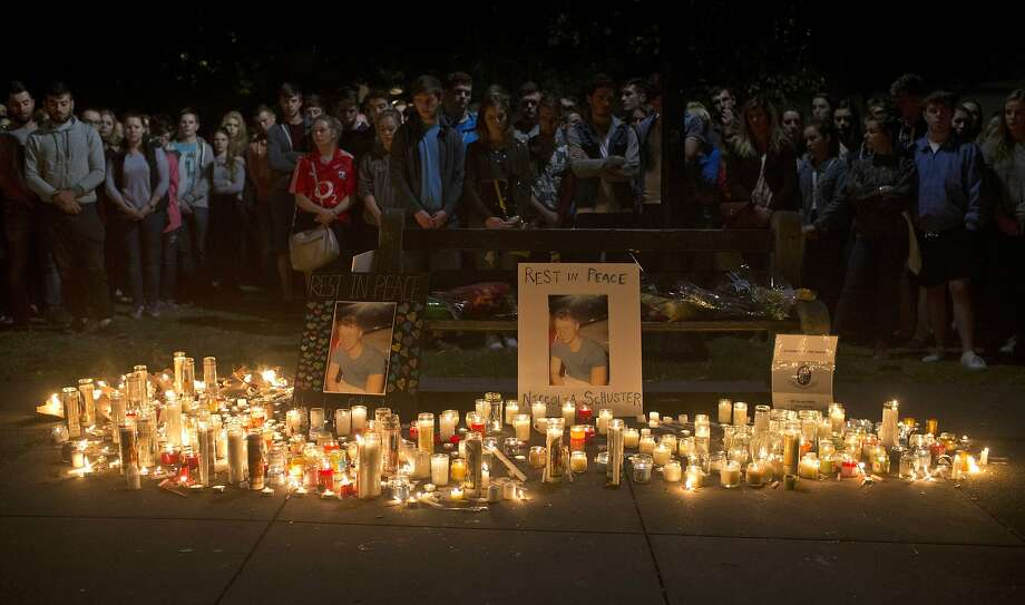 A vigil is held Wednesday for six students killed in a balcony collapse. Photo: Beck Diefenbach, Associated Press