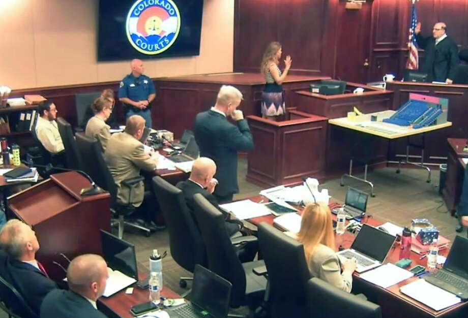 In this image taken from video, Hillary Fay Allen (second from right at top), a former fellow graduate student with Colorado theater shooter James Holmes, is sworn in prior to giving testimony during the trial of Holmes, pictured at top left in light-colored shirt. Prosecutor George Brauchler is pictured standing at center. Photo: Associated Press