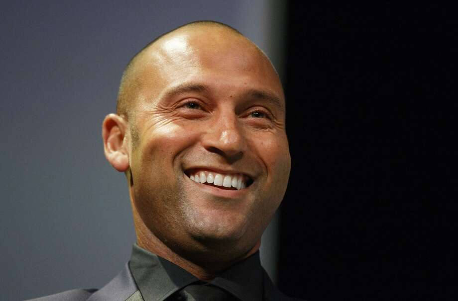 In this photo taken Tuesday, May 26, 2015, fetired baseball star Derek Jeter shares a laugh during The 28th Annual Economics Club of Grand Rapids awards dinner at DeVos Place in Grand Rapids, Mich. (Hugh Carey/The Grand Rapids Press via AP) ALL LOCAL TELEVISION OUT; LOCAL TELEVISION INTERNET OUT Photo: Hugh Carey, Associated Press