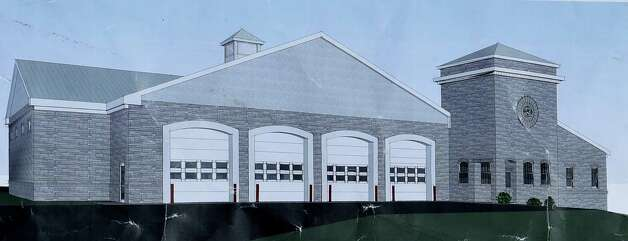 An artists rendering is shown at the announcement of FEMA funds Friday morning June 19, 2015,  to build a new firehouse for the Schoharie Niagara Engine 6 Fire Company       (Skip Dickstein/Times Union) Photo: SKIP DICKSTEIN / 00032335A