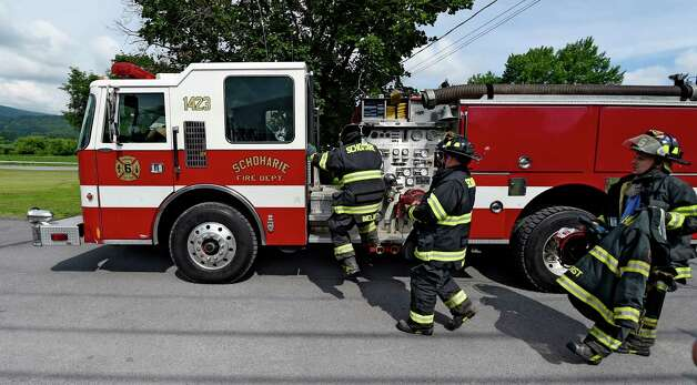 Firefighters move quickly to their engine and proceed to a fire during the announcement of FEMA funds Friday morning June 19, 2015,  to build a new firehouse for the Schoharie Niagara Engine 6 Fire Company       (Skip Dickstein/Times Union) Photo: SKIP DICKSTEIN / 00032335A
