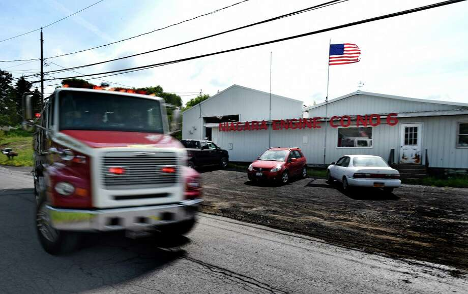 One of the fire engines leaves for a fire call during the announcement of FEMA funds Friday morning June 19, 2015,  to build a new firehouse for the Schoharie Niagara Engine 6 Fire Company       (Skip Dickstein/Times Union) Photo: SKIP DICKSTEIN / 00032335A