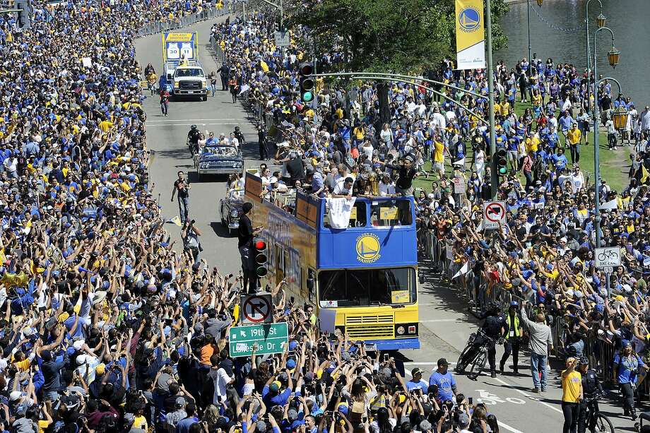 Stephen Curry waves to fans along Lake Merritt during the Golden State Warriors Championship Parade in Oakland, CA Friday, June 19, 2015. Photo: Michael Short, Special To The Chronicle