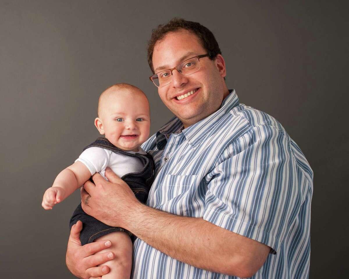 Rabbi David L. Reiner and his son, Samson, 7 months