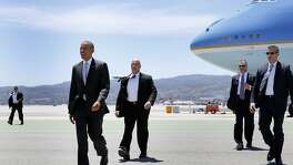 President Barack Obama steps off Air Force One at San Francisco Airport in San Francisco, California, on Friday, June 19, 2015. He is in the Bay Area Friday to speak at a mayor's conference and two fundraisers.