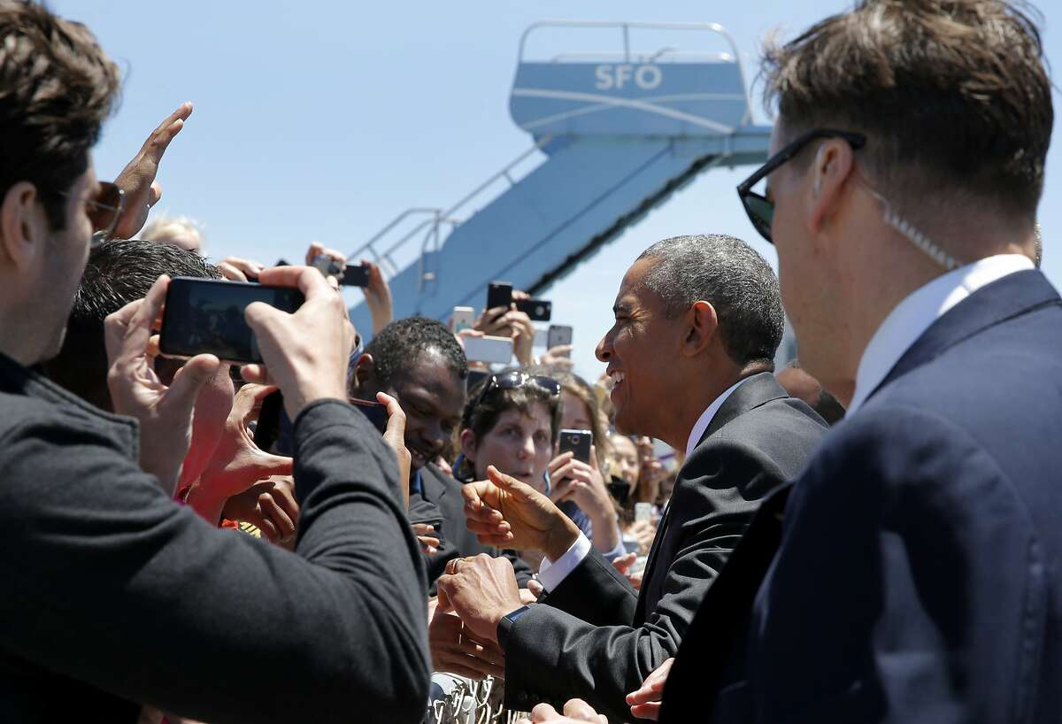 President Barack Obama greets people at San Francisco Airport in San Francisco, California, on Friday, June 19, 2015. He is in the Bay Area Friday to speak at a mayor's conference and two fundraisers.