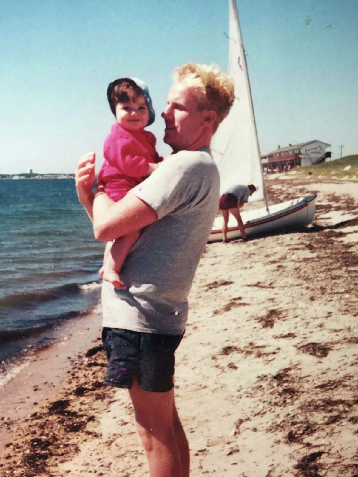 Katie Davidson, as a toddler, with her father, Brian, at the beach.