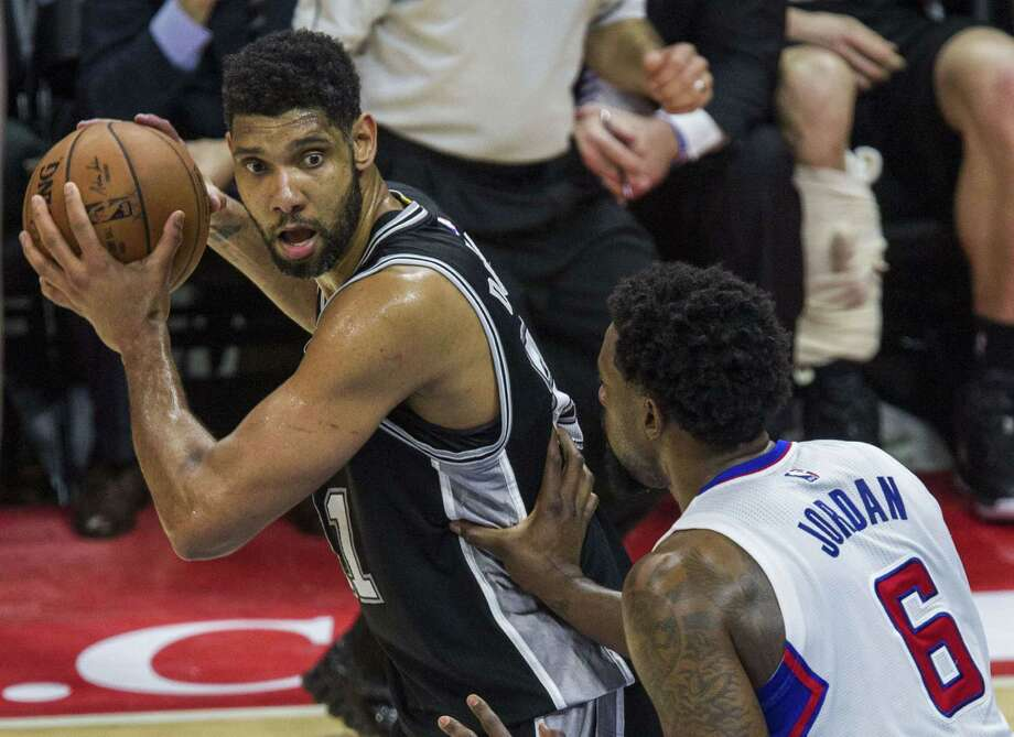 San Antonio Spurs Tim Duncan (L) poses against  Los Angeles Clippers DeAndre Jordan during the first half of their first round NBA playoff game at Staples Center in Los Angeles, California on May 2, 2015. AFP PHOTO/ Ringo ChiuRINGO CHIU/AFP/Getty Images Photo: RINGO CHIU, Stringer / AFP / Getty Images / AFP