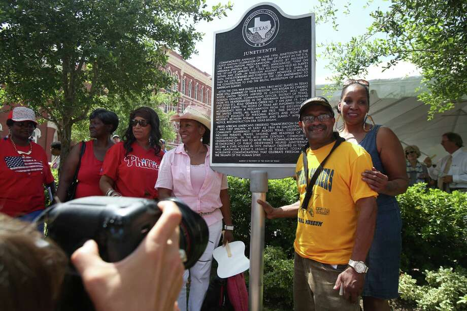Visitors wait their turn to be photographed with the Juneteenth Historical Marker in Galveston. Photo: Mayra Beltran, Staff / © 2014 Houston Chronicle