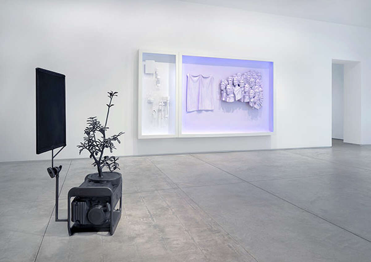 """An installation view of Michael Jones McKean's show """"one hundred twenty six million acres"""" at Inman Gallery, including the sculpture """"the shade,"""" made with a diesel generator, and the diptych """"we are see-through we never die."""""""