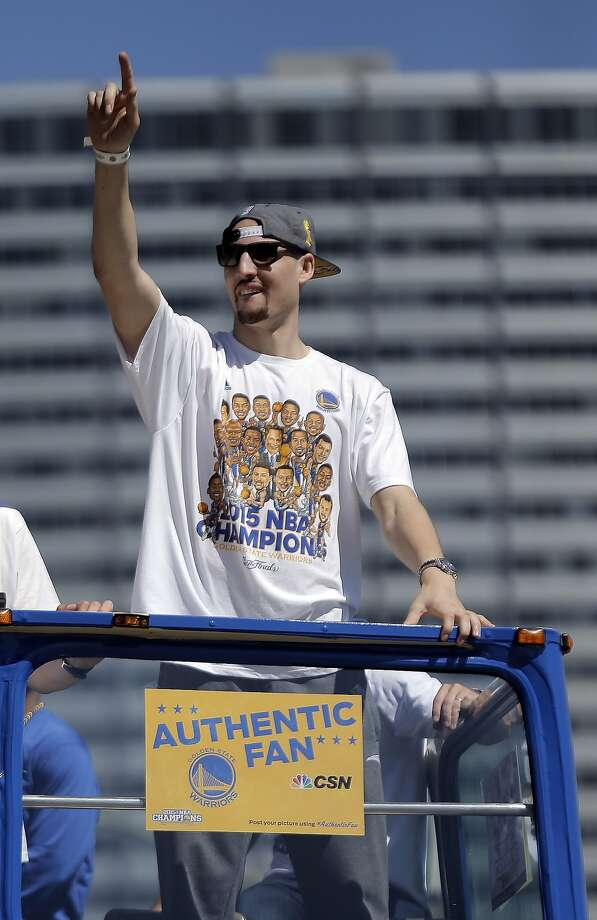 Klay Thompson acknowledges the crowd on Lakeside Drive on Friday. The Golden State Warriors celebrated their first NBA Championship in 40 years with a parade through Oakland, Calif.,  on Friday, June 19, 2015. Photo: Carlos Avila Gonzalez, The Chronicle