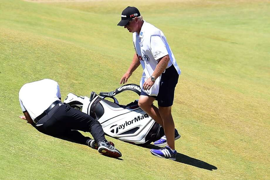 UNIVERSITY PLACE, WA - JUNE 19:  Jason Day of Australia lays on the ninth green after falling due to dizziness during the second round of the 115th U.S. Open Championship at Chambers Bay on June 19, 2015 in University Place, Washington. Photo: Getty Images