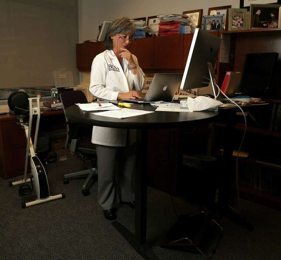 Among health-conscious adults, standing desks are already in vogue. Photo: Karen Warren, Staff / © 2013 Houston Chronicle