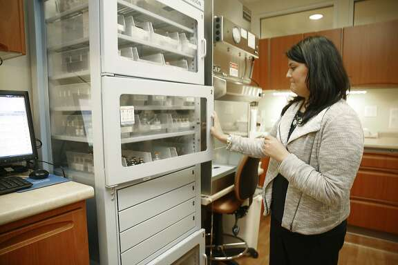 Director of pharmacy services Michelle Taymuree at Diablo Valley oncology/hematology in Pleasant Hill, Calif., looks through medication on Friday, June 19, 2015.