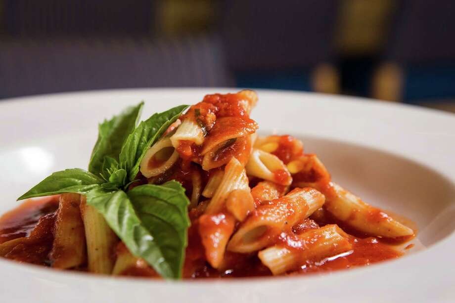 A plate of penne pomodoro is shown at Trevisio Restaurant in the Texas Medical Center on Thursday, June 18, 2015, in Houston. ( Brett Coomer / Houston Chronicle ) Photo: Brett Coomer, Staff / © 2015 Houston Chronicle