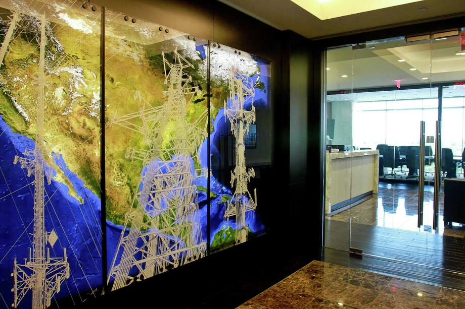 The entrance to Crown Castle offices at 1220 Augusta Drive. Crown Castle is the nation's largest provider of wireless infrastructure. On the wall is commissioned artwork by Joe Aker. This, and other pieces of his work decorate their offices and reflect their business. Photo: Gary Fountain, For The Chronicle / Copyright 2015 by Gary Fountain