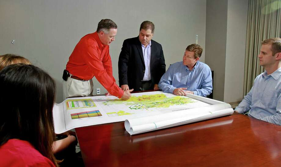 John Jasek, from left, Lee K. Boothby, Steve Campbell and Forrest Robinson during meeting at Newfield Exploration Co. Photo: Gary Fountain, For The Chronicle / Copyright 2015 by Gary Fountain