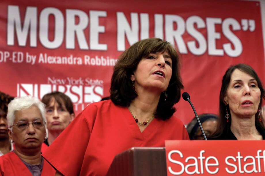 President Judy Sheridan-Gonzalez, left, and Executive Director Jill Furillo, right, of the New York State Nurses Association, address a news conference, in New York, Wednesday, June 3, 2015. The union representing more than 18,000 registered nurses at 14 of New York City's private hospitals says members have voted to authorize a strike if contract negotiations aren't carried out in good faith. The New York State Nurses Association says the main issue for its members is staffing level at the hospitals. (AP Photo/Richard Drew) Photo: Richard Drew / AP