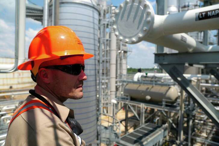 Operation's Superintendent at Kinder Morgan Derrick Bockius stands on one of the Distillation Towers at the Kinder Morgan Splitter facility in Galena Park, Texas, June 2, 2015.