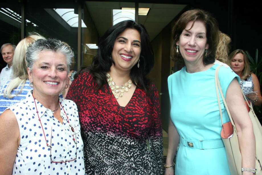 Enjoying the Fort Bend Cares reception were, from left, Pat Somers, Kavita Self, and Elizabeth Bayless.  Somers and Self represented recipient Parks Youth Ranch;  Bayless was there for Memorial Hermann Foundation. Photo: Joan Vogan / For The Chronicle