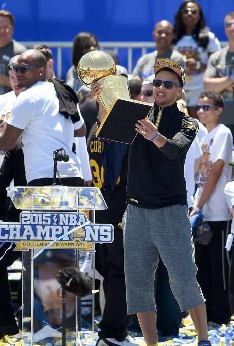 Steph Curry shows off the NBA championship trophy. Photo: Thearon W. Henderson, Getty Images