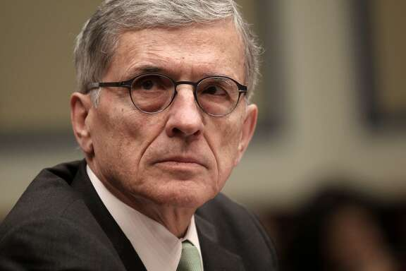 """In this photo taken March 17, 2015, Federal Communications Commission (FCC) Chairman Tom Wheeler testifies on Capitol Hill in Washington. Tired of automated phone calls urging you to vote for a certain candidate or pitching a cruise vacation? You can now tell your phone company that federal regulators say it's OK to block them. The FCC on Thursday agreed that Verizon, AT&T and other telecommunication carriers aren't duty-bound to connect those annoying """"robocalls"""" if a consumer doesn't want them. Consumer groups and several states had asked the federal regulator to clarify this point because phone companies have said they worry about running afoul of rules that require them to connect every call. (AP Photo/Lauren Victoria Burke)"""