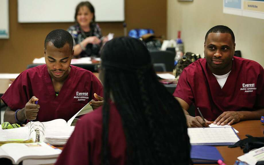 Adolph Mbula, left, and Jared Robertson, right, take notes in a Medical Administration Assistant class at Everest Institute which use to be Corinthian College, on Tuesday, May 12, 2015. Photo: Bob Owen, Staff / San Antonio Express-News / San Antonio Express-News
