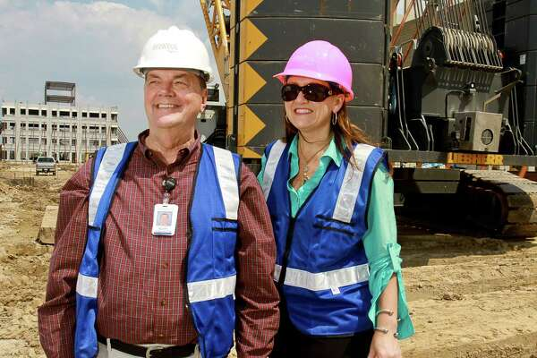 Scott Barbe, sr. vice president and CEO, and Courtney Altimore, director of business development, for Memorial Hermann Cypress, observing the campus construction of Memorial Hermann Cypress.  The Medical Plaza, is behind them on the left. The facility is at Highway 290 and Grand Parkway, between Mason Road and Mueschke Road, and is scheduled to open in 2016.