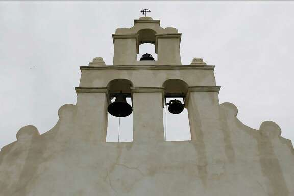 A mockingbird sits atop the chapel at Mission San Juan Capistrano on June 19. Officials held a ceremony at the mission to mark the expansion of lands around the San Antonio