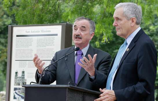 "Justice of the Peace Ciro Rodriguez (center) and U.S. Congressman Lloyd Doggett address an audience during a ceremony at Mission San Juan Capistrano to mark the expansion of lands around the San Antonio Missions in order to preserve the land and environment on Friday, June 19, 2015. ""The San Antonio Missions Historical Park protects our nation's largest collection of Spanish colonial resources, and today we extend that protection even further, enhancing the experience of visitors to the Missions and vastly expanding the park's economic impact on the city of San Antonio,"" said Suzanne Dixon of the National Parks Conservation Association in a press release. The San Antonio River Authority and the City of San Antonio will transfer about 60.5 acres of land around Mission San Juan to the National Park Service as part of the preservation efforts. (Kin Man Hui/San Antonio Express-News) Photo: Kin Man Hui, Staff / San Antonio Express-News / ©2015 San Antonio Express-News"