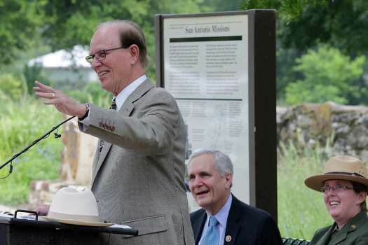 "Bexar County Judge Nelson Wolff speaks during a ceremony at Mission San Juan Capistrano to mark the expansion of lands around the San Antonio Missions in order to preserve the land and environment on Friday, June 19, 2015. ""The San Antonio Missions Historical Park protects our nation's largest collection of Spanish colonial resources, and today we extend that protection even further, enhancing the experience of visitors to the Missions and vastly expanding the park's economic impact on the city of San Antonio,"" said Suzanne Dixon of the National Parks Conservation Association in a press release. The San Antonio River Authority and the City of San Antonio will transfer about 60.5 acres of land around Mission San Juan to the National Park Service as part of the preservation efforts. (Kin Man Hui/San Antonio Express-News) Photo: Photos By Kin Man Hui / San Antonio Express-News / ©2015 San Antonio Express-News"