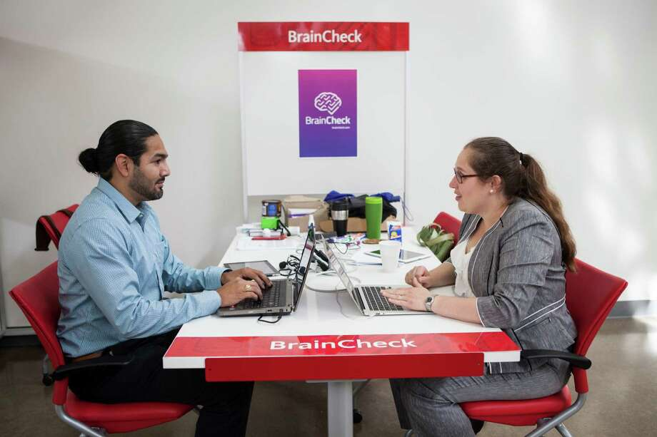 Yael Katz, right , the CEO of BrainCheck, and Benjamin Flores, left, work at their station in the TMCX offices. Photo: Scott Dalton, Chronicle / 2015 Houston Chronicle