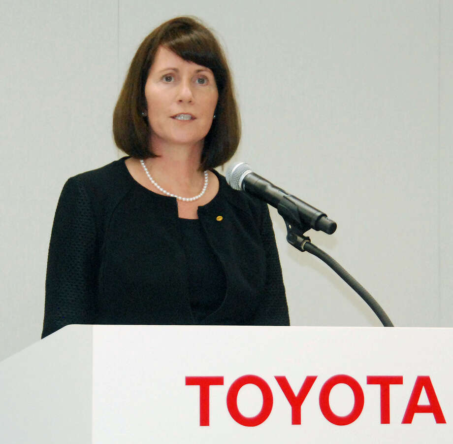 Julie Hamp, Toyota Motor Corp.'s new head of public relations, speaks during a press conference in Toyota, central Japan, Wednesday, June 17, 2015.  Hamp was arrested Thursday, June 18,  on suspicion of importing an illegal pain medicine into Japan, Tokyo police said.  Hamp, an American, was appointed in April as Toyota's first female top executive. She had been moving her things to Japan from California, where she had been head of communications for Toyota's U.S. operations.  (Kyodo News via AP) JAPAN OUT, CREDIT MANDATORY Photo: SUB / Kyodo News