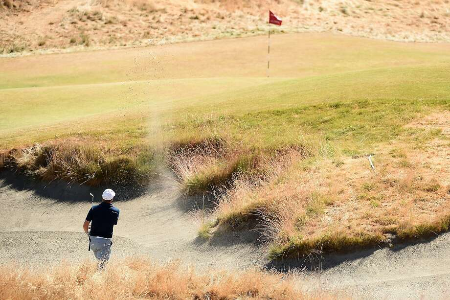 """Jordan Spieth hits a shot from a greenside bunker on the 18th hole during the second round of the U.S. Open at Chambers Bay. """"This is the dumbest hole I've ever played in my life,"""" he says. Photo: Harry How, Getty Images"""