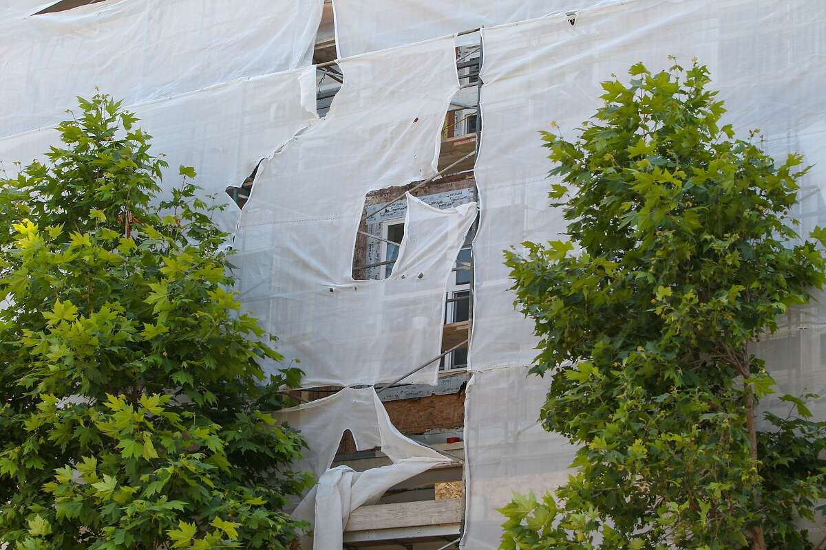 Scaffolding is seen on the El Camino Real side of the Park Broadway building in Millbrae, California, on Friday, June 19, 2015. Extensive renovations are taking place because structural damage resulting from faulty workmanship by Segue Construction was uncovered. Segue Construction is one of the companies that worked on the Library Gardens apartments at 2020 Kittredge Street in Berkeley, where 6 people died on Tuesday after a balcony collapsed.