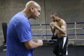 In this June 1, 2015 photo, Andre Ward, right, works out with trainer Virgil Hunter in Hayward, Calif. Super Middleweight champion Andre Ward is ready for his 19-month layoff to come to an end Saturday, June 20, 2015, when he takes on England's Paul Smith in a non-title fight. (AP Photo/Jeff Chiu)