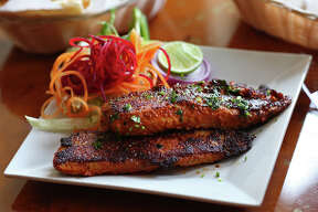 The Tawa fish comes with salad at the Cafe Bahar, located at 10227 Ironside, Monday, March 30, 2015. The dish is one of several spicy entrees offered at the Indian restaurant.