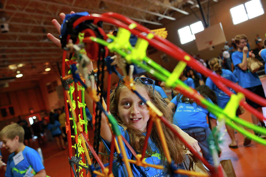 Madison Gwosdz puts a car in motion during the Karnes County Eagle Ford Energy Camp. Photo: Lisa Krantz /San Antonio Express-News / San Antonio Express-News