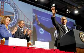 President Barack Obama waves to the crowd before speaking at a mayor's conference in San Francisco, California, on Friday, June 19, 2015.