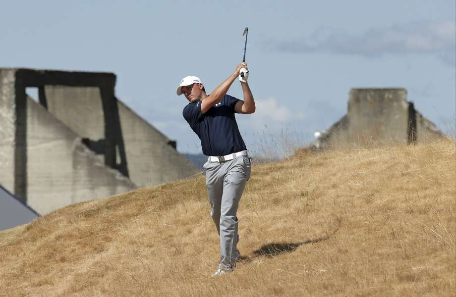Jordan Spieth hits out of the tall fescue grass on the 18th hole during the second round of the U.S. Open golf tournament at Chambers Bay on Friday, June 19, 2015 in University Place, Wash. (AP Photo/Charlie Riedel) Photo: Charlie Riedel, AP